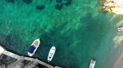 Small boats in bay aerial view Stock Footage