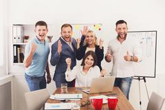 Happy business people team celebrate success in the office Stock Photos