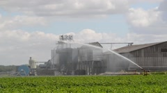 Water cannon watering crops in field by farm united kingdom Stock Footage