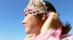 A girl's face with Pink bow on head, close-up Stock Footage