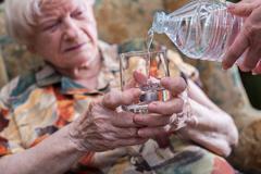 Home assistance of seniors Stock Photos