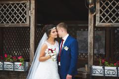 Wedding couple in a garden Stock Photos