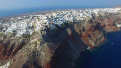 Aerial footage - White houses and blue domes of Oia, Santorini. Arkistovideo