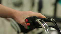 Person pressing brake lever on electric bicycle handle, modern smart transport Stock Footage