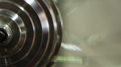 Steel round object rotating indefinitely, eternal motion, everyday routine Stock Footage
