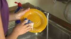 Woman washing the dish  Stock Footage