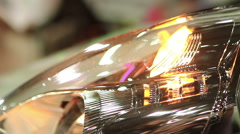 Close up of auto headlamp, hazard warning lights blinking, car breakdown signal Stock Footage