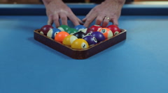Man Racking Pool Balls in Eight-Ball Formation on Blue Billiards Table Stock Footage