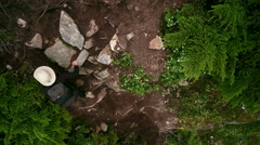 Adventurous Female with Backpack Climbing Up Steep Rugged Cliffside Trail - stock footage