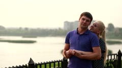 couple in love having fun outdoors enjoying an intimate moment of romance - stock footage