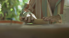 Hand Man Throws a Table With Flour and Rolls Raw Dough Stock video footage Stock Footage