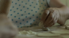 Senior woman hands knead dough on a table stock video footage Stock Footage