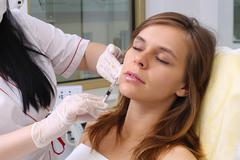 Mesotherapy injections in the face. Stock Photos