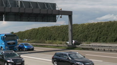 Airplane taxiing over bridge, highway A3 Stock Footage