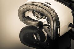 Virtual reality goggles on dark surface Stock Photos
