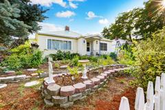 Curb appeal of old house with nice landscape design. Northwest, USA Stock Photos