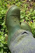 Farmer green boots view Stock Photos