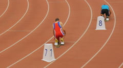Male athletes start at a distance of 400 meters in stadium Stock Footage