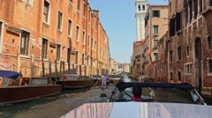 Venice, Italy - June 19, 2016: Riding on the vaporetto to the small canal in Stock Footage