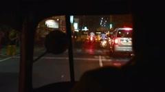 Shot of Chennai traffic through rickshaw windshield at night Stock Footage