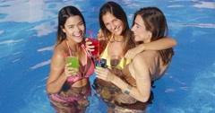Three vivacious women enjoying cocktails Stock Footage