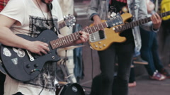 Street Musicians Playing a Guitars Stock Footage