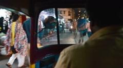Shot of local Indian market through rickshaw windshield Stock Footage