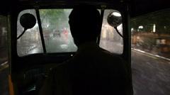 Shot of Chennai pouring rain through rickshaw windshield at night Stock Footage