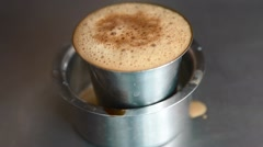 Hot filter coffee in a steel glass Stock Footage