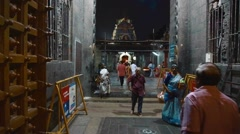 Indians walking in south Indian temple at night Stock Footage