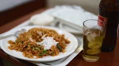 Indian biryani paired with kingfisher beer and ice Stock Footage