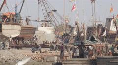 Busy scene in harbour,Porbandar,India Stock Footage