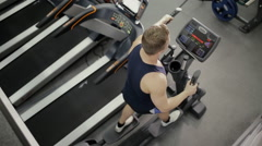 Sportsman doing cardio exercise in gym Stock Footage
