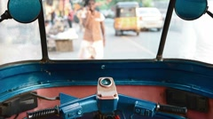 Driver's view of people walking through windshield of stationery rickshaw Stock Footage