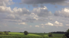4K Light Puffy Clouds Float Across Farm Crops Cornfield Time Lapse Stock Footage