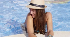 Smiling long haired beauty wearing bikini and hat Stock Footage