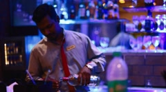 Bartender pours drink into dual measuring cup Stock Footage