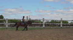 Riding horse. Girl on beautiful horse riding on manege. Stock Footage