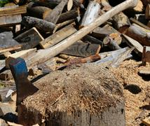 Big ax of the woodcutter on the block of wood in the woodshed Stock Photos
