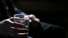 Man holding a glass of whiskey in his right hand Stock Footage
