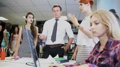 Business and startup concept - happy creative team discussing project in office Stock Footage