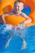 Little boy on an inflatable circle in the water Kuvituskuvat