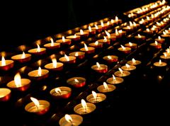 Many candles lit inside the place of worship Stock Photos