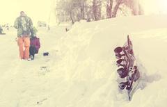 Snowboard lying on snowdrift on the hillside Stock Photos