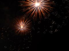 Two colorful fireworks in the dark sky Stock Photos
