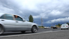 Timelapse moving vehicles on a background of blue clouds Stock Footage