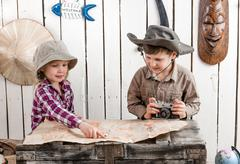 Two little children watching map Stock Photos