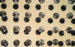 Wooden sunshade umbrellas on a beach Stock Photos