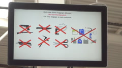 Security informations on departure screen in airport terminal. Beauvais, France. Stock Footage