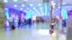 Blurred people walking in modern shopping mall. 4K bokeh video - stock footage